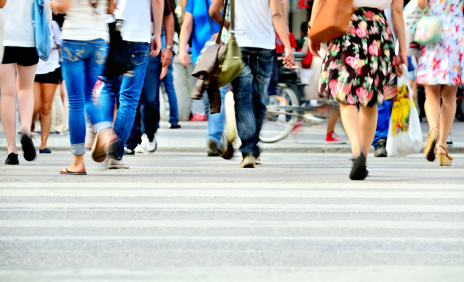 image of legs of people walking in the street