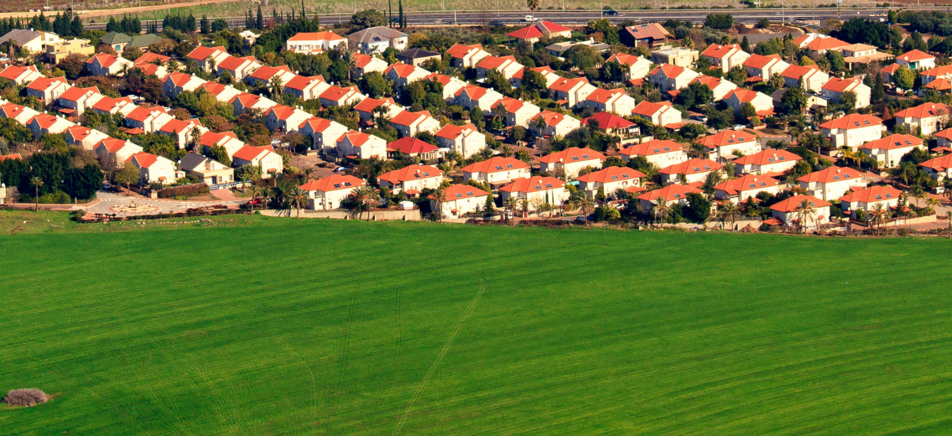 A feild next to houses