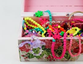 a box filled with children's jewelry