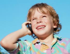 image of child speaking on cell phone