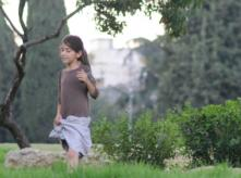 image of girl walking in park