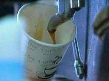 image of coffee being pured to a cup in a coffee machine