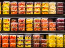 Packaged fruit in supermarket fridge