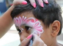 a child's face painted