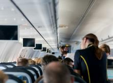 Flight attendant on board a flight