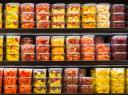 Packaged fruit in supermarket fridge