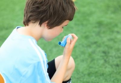 A kid using Asthma inhaler