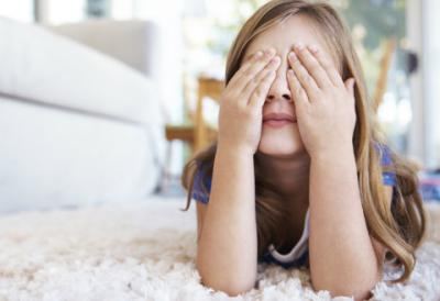 A girl playing on a rug