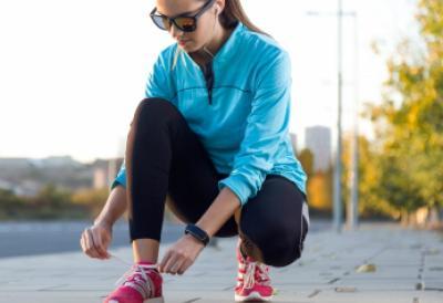 Female Athlete Tying Laces For Jogging - Image courtesy of nenetus at FreeDigitalPhotos.net