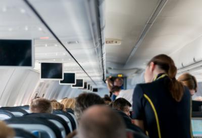 Flight attendant on board a flight