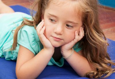 Girl on nap mat in Kindergarten